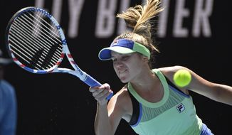 Sofia Kenin of the U.S. makes a forehand return to Tunisia's Ons Jabeur during their quarterfinal match at the Australian Open tennis championship in Melbourne, Australia, Tuesday, Jan. 28, 2020. (AP Photo/Andy Brownbill)