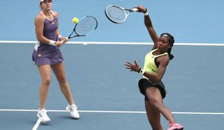 United States' Coco Gauff, right, and compatriot Caty McNally play in their third round doubles match against Japan's Shuko Aoyama and Ena Shibahara at the Australian Open tennis championship in Melbourne, Australia, Monday, Jan. 27, 2020. (AP Photo/Dita Alangkara)
