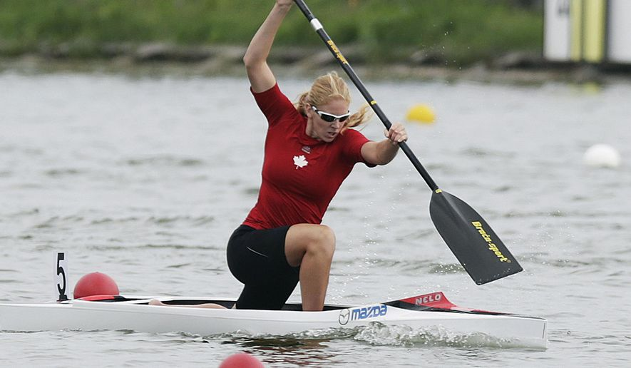 FILE - In this Sunday, Aug. 10, 2014 file photo, winner Laurence Vincent-Lapointe of Canada competes at the C1 women 200m final of the ICF Canoe Sprint World Championships 2014 in Moscow, Russia. A world champion canoeist won a doping case Monday, Jan. 27, 2020 after persuading a tribunal that her positive test was caused by bodily fluid contamination from her boyfriend. The International Canoe Federation ended its investigation into 11-time world champion Laurence Vincent Lapointe, who tested positive for a steroid-like substance in July. (AP Photo/Pavel Golovkin, file)