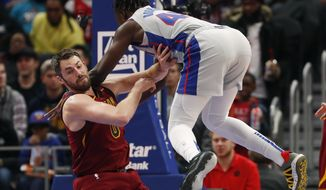 Detroit Pistons forward Sekou Doumbouya (45) falls onto Cleveland Cavaliers forward Kevin Love during the first half of an NBA basketball game, Monday, Jan. 27, 2020, in Detroit. (AP Photo/Carlos Osorio)