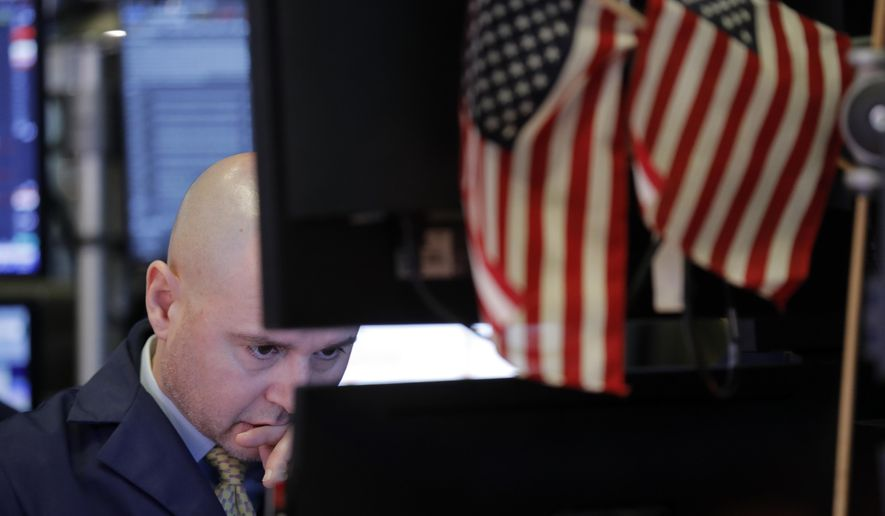 In this Jan. 8, 2020, file photo a trader works on the floor at the New York Stock Exchange in New York. The U.S. stock market opens at 9:30 a.m. EST on Monday, Jan. 27. (AP Photo/Seth Wenig, File)