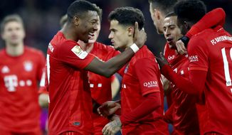 Bayern's scorer Philippe Coutinho, center, and his teammate David Alaba, front left, celebrate their side's sixth goal during the German Bundesliga soccer match between FC Bayern Munich and SV Werder Bremen in Munich, Germany, Saturday, Dec. 14, 2019. (AP Photo/Matthias Schrader)