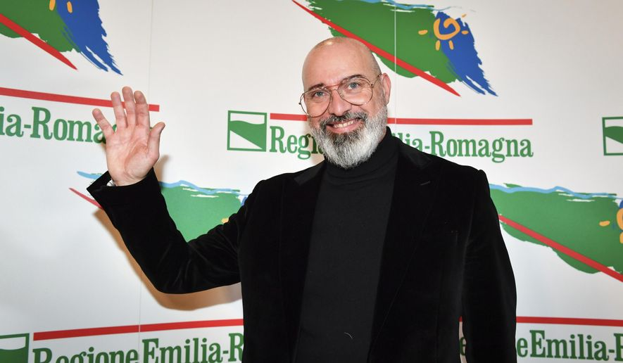 Center-left candidate Stefano Bonaccini meets the media after polls closed in a regional election for the region of Emilia Romagna, in Bologna, Italy, late Sunday, Jan. 26, 2020. Nearly complete results Monday, Jan. 27, 2020, of balloting for the governorship of the prosperous Emilia-Romagna region had the League's candidate some 8 percentage points behind the 51.4 percent garnered in Sunday's balloting, by the incumbent governor, of the center-left Democrats, Bonaccini.  (Massimo Paolone/LaPresse via AP)