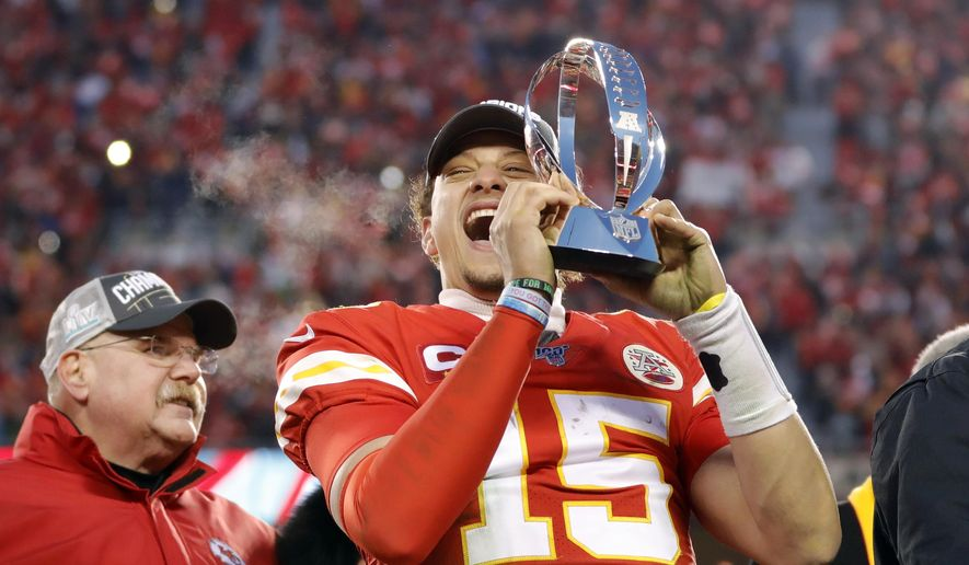 In this Jan. 19, 2020, photo, Kansas City Chiefs quarterback Patrick Mahomes holds the Lamar Hunt Trophy as he celebrates winning a NFL, AFC Championship football game against the Tennessee Titans in Kansas City, Mo. The most compelling dramas in the NFL this season unfolded on the field, not off of it. And any thought that the league was in jeopardy of losing its spot as America's favorite sport has been set on the back burner. (AP Photo/Colin E. Braley)  **FILE**