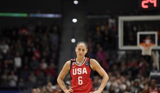 United States' Sue Bird stands for a 24 second shot-clock violation to honor Kobe Bryant during an exhibition basketball game in the first half of a basketball game against Connecticut, Monday, Jan. 27, 2020, in Hartford, Conn. (AP Photo/Jessica Hill)