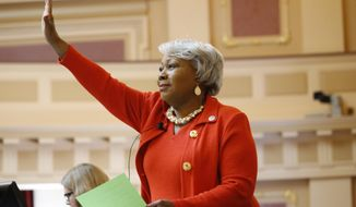 Senate President Pro Tempore, Sen. Louise Lucas, D-Portsmouth, recognizes a visitor in the gallery as she presides over the Senate at the Capitol, Monday Jan 27, 2020, in Richmond, Va. (AP Photo/Steve Helber)