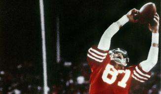 "Receiver Dwight Clark makes ""The Catch"" on a pass from Joe Montana that tied the game late in the fourth quarter against the Cowboys in the 1982 NFC championship game. The play kicked off an era that saw the 49ers win five Super Bowl titles from 1981 to 1994. (ASSOCIATED PRESS)"