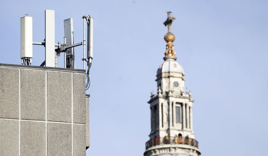 """Mobile network phone masts are visible in front of St Paul's Cathedral in the City of London, Tuesday, Jan. 28, 2020. The Chinese tech firm Huawei has been designated a """"high-risk vendor"""" but will be given the opportunity to build non-core elements of Britain's 5G network, the government has announced. The company will be banned from the """"core"""", of the 5G network, and from operating at sensitive sites such as nuclear and military facilities, and its share of the market will be capped at 35%. (AP Photo/Alastair Grant)"""