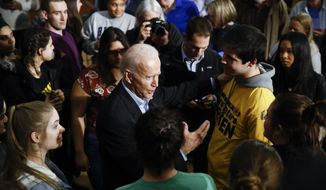 Democratic presidential candidate former Vice President Joe Biden meets with attendees during a campaign event, Monday, Jan. 27, 2020, in Iowa City, Iowa. (AP Photo/Matt Rourke)