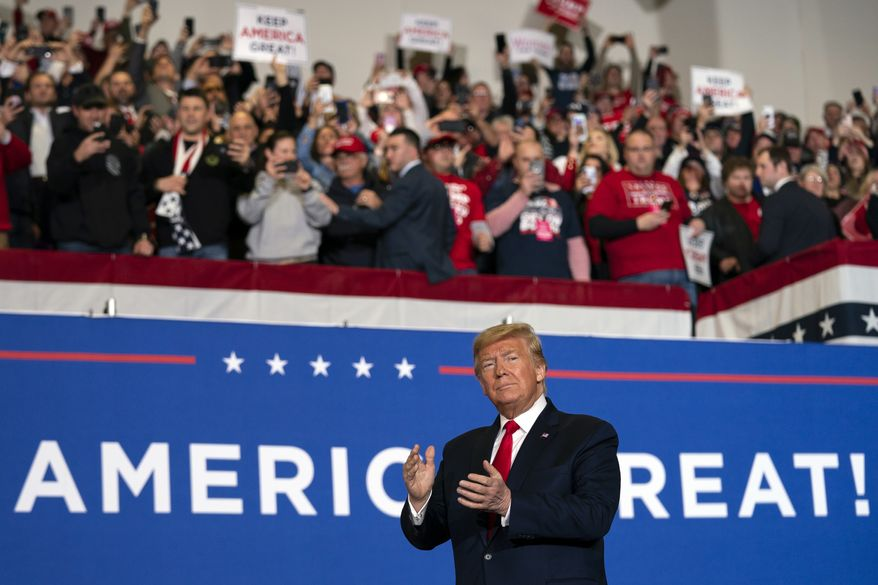 President Donald Trump arrives to speak at a campaign rally at the Wildwoods Convention Center Oceanfront, Tuesday, Jan. 28, 2020, in Wildwood, N.J. (AP Photo/ Evan Vucci)