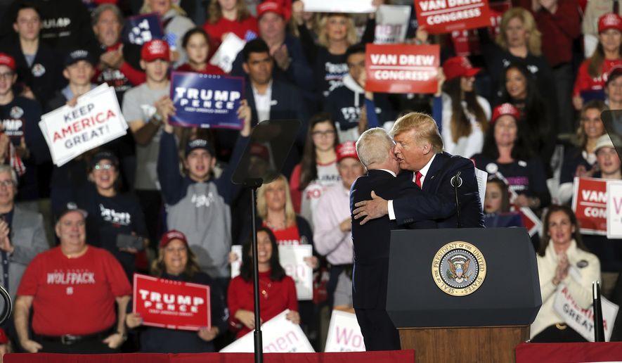 President Donald Trump greets Rep. Jeff Van Drew, R-N.J., at a campaign rally Tuesday, Jan. 28, 2020, in Wildwood, N.J. (AP Photo/Mel Evans)