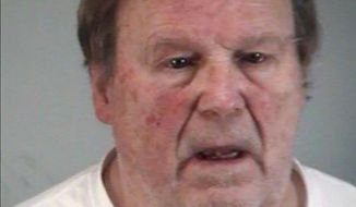 In this Monday, Jan. 27, 2020, photo made available by the Lake County Sheriff's Office, Wolfgang Halbig is under arrest. Halbig who repeatedly harassed parents of shooting victims at Sandy Hook Elementary School was arrested and charged Monday for possessing the identification of one of the parents, authorities said. (Lake County Sheriff's Office via AP)