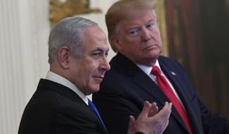 President Donald Trump, right, looks over to Israeli Prime Minister Benjamin Netanyahu, left, during an event in the East Room of the White House in Washington, Tuesday, Jan. 28, 2020, to announce the Trump administration's much-anticipated plan to resolve the Israeli-Palestinian conflict. (AP Photo/Susan Walsh)