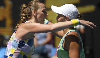 Australia's Ashleigh Barty, right, is congratulated by Petra Kvitova of the Czech Republic after winning their quarterfinal match at the Australian Open tennis championship in Melbourne, Australia, Tuesday, Jan. 28, 2020. (AP Photo/Andy Brownbill)