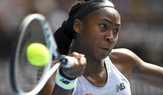 Coco Gauff of the U.S. makes a forehand return to compatriot Sofia Kenin during their fourth round singles match at the Australian Open tennis championship in Melbourne, Australia, Sunday, Jan. 26, 2020. (AP Photo/Andy Brownbill)