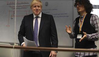 Britain's Prime Minister Boris Johnson, center, visits the Department of Mathematics at King's Maths School, part of King's College London University, in London, Monday Jan. 27, 2020. (Daniel Leal-Olivas/Pool via AP)