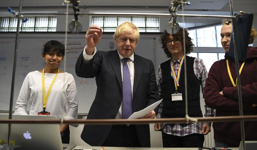 Britain's Prime Minister Boris Johnson, center left, visits the Department of Mathematics at King's Maths School, part of King's College London University, in London, Monday Jan. 27, 2020. (Daniel Leal-Olivas/Pool via AP)