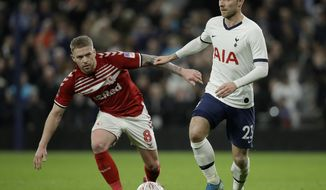 Middlesbrough's Adam Clayton, left, and Tottenham's Christian Eriksen challenge for the ball during the English FA Cup third round replay soccer match between Tottenham Hotspur and Middlesbrough FC at the Tottenham Hotspur Stadium in London, Tuesday, Jan. 14, 2020.(AP Photo/Matt Dunham)