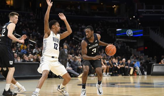Butler guard Kamar Baldwin (3) dribbles the ball next to Georgetown guard Terrell Allen (12) during the first half of an NCAA college basketball game, Tuesday, Jan. 28, 2020, in Washington. (AP Photo/Nick Wass) ** FILE **