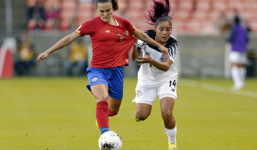 Panama defender Maryorie Perez (14) pulls on the jersey of Costa Rica forward Melissa Herrera (7) during the first half of a women's Olympic qualifying soccer match Tuesday, Jan. 28, 2020, in Houston. (AP Photo/Michael Wyke)
