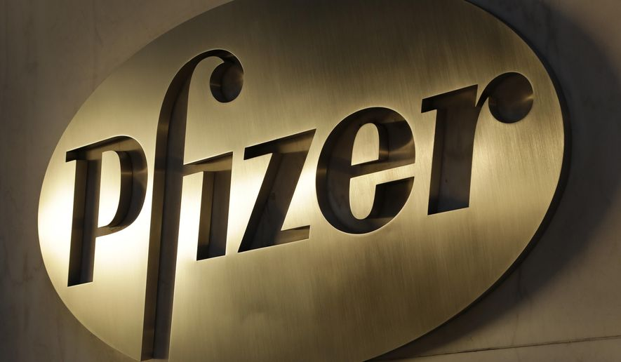 FILE - In this Nov. 23, 2015, file photo, the Pfizer logo is displayed at world headquarters in New York.  Pfizer is reporting a $306 million loss for the fourth quarter after it shifted its consumer health business into a joint venture last year. It narrowly Wall Street expectations for net income when nonrecurring events are removed. The biggest US drugmaker on Tuesday, Jan. 28, 2020 reported a net loss of  6 cents per share.   (AP Photo/Mark Lennihan, File)