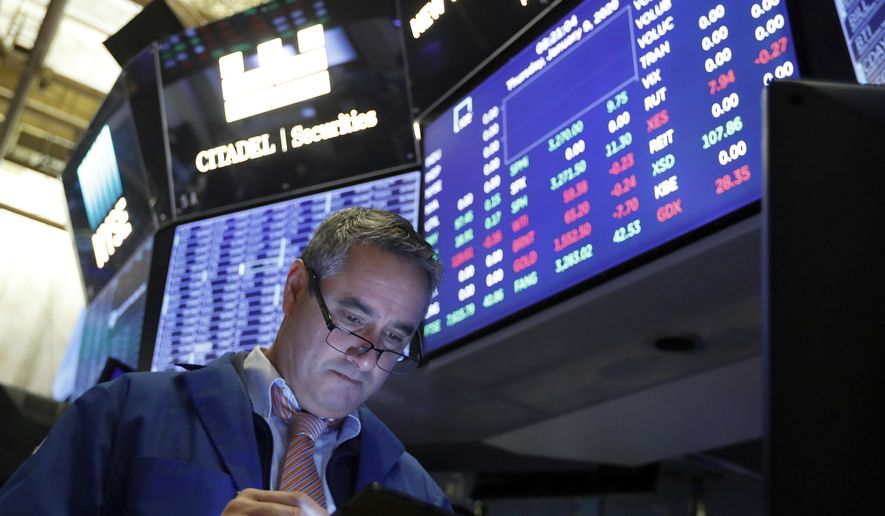 FILE - In this Jan. 9, 2020, file photo trader Daniel Trimble works on the floor of the New York Stock Exchange. The U.S. stock market opens at 9:30 a.m. EST on Tuesday, Jan. 28. (AP Photo/Richard Drew, File)