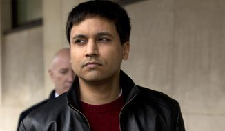 """FILE - In this March 23, 2016 file photo, British futures trader Navinder Singh Sarao leaves after the ruling in his extradition hearing at Westminster Magistrates Court in London. A U.S. judge on Tuesday, Jan. 28, 2020, sentenced Navinder Singh Sarao, a socially awkward math whiz-turned-futures trader who helped trigger a U.S. stock market """"flash crash"""" from his parents' suburban London home to time served and a year's home confinement, sparing him imprisonment after prosecutors praised his cooperation and said his crimes were unmotivated by greed. (AP Photo/Matt Dunham, File)"""