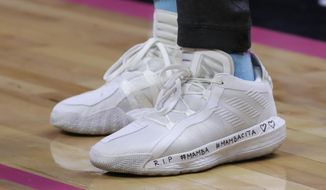 Miami Heat guard Goran Dragic wears inscribed shoes as a tribute to NBA basketball player Kobe Bryant before a game against the Orlando Magic, Monday, Jan. 27, 2020, in Miami. Bryant and his daughter were among those who died in a helicopter crash Sunday in California. (AP Photo/Lynne Sladky)