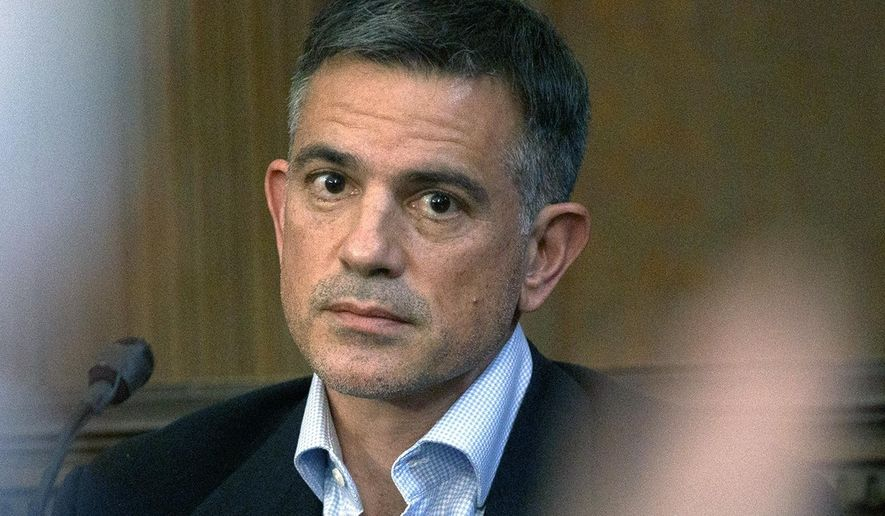 FILE - In this Dec. 4, 2019, file photo, Fotis Dulos,  charged with murdering his estranged and missing wife, is questioned during testimony in a civil case at Hartford Superior Court in Hartford, Conn.  A dispatcher from the Farmington police said, on Tuesday, Jan. 28, 2020, officers had responded to Dulos' home and he was later transported to the hospital. (Mark Mirko/Hartford Courant via AP, Pool, File)