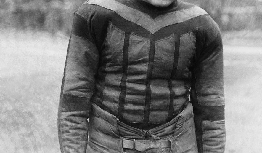 """This undated file photo shows football player Harold """"Red"""" Grange. From the crude, oblong leather helmets to the sparsely padded brown and blue vertical-striped uniforms of the Chicago Bears, it's easy to see how equipment has drastically evolved in the NFL since the days of The Galloping Ghost in the 1920s and '30s. From their heads to their toes, the players' looks through the decades have changed so much, it's tough to believe it's all the same sport. (AP Photo)"""