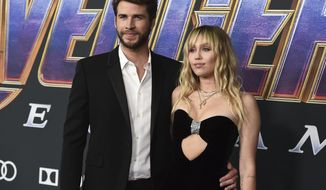 "FILE - This April 22, 2019 file photo shows Liam Hemsworth, left, and Miley Cyrus arrive at the premiere of ""Avengers: Endgame"" in Los Angeles. Cyrus and Hemsworth are legally single. Court records show that a Los Angeles judge on Tuesday, Jan. 28, 2020, finalized the divorce that ended the brief marriage. The couple separated and Hemsworth filed for divorce in August, about eight months after he and Cyrus married. (Photo by Jordan Strauss/Invision/AP, File)"