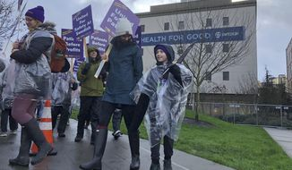 Swedish Medical Center nurses and other workers picket outside the hospital's campus in the Ballard neighborhood of Seattle as they began a three-day strike Tuesday, Jan. 28, 2020, over staffing levels, wages and other issues. The hospital system closed two of its seven emergency departments and brought in replacement workers in response to the strike. (AP Photo/Gene Johnson)