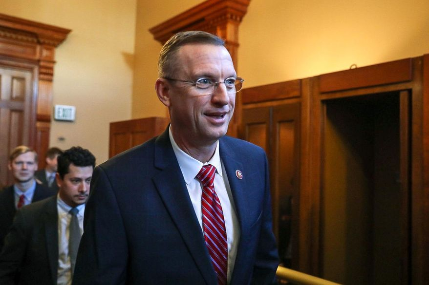 Georgia Rep. Doug Collins walks with colleagues at the state capitol in Atlanta, Tuesday, Jan. 28, 2020. (Riley Bunch/The Daily Times via AP) ** FILE **