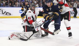 Buffalo Sabres defenseman Rasmus Ristolainen (55) is stopped by Ottawa Senators goalie Craig Anderson (41) during the first period of an NHL hockey game Tuesday, Jan. 28, 2020, in Buffalo, N.Y. (AP Photo/Jeffrey T. Barnes)