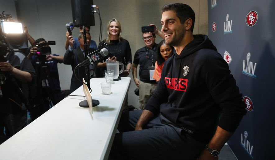 San Francisco 49ers quarterback Jimmy Garoppolo smiles as he speaks during a media availability for the NFL Super Bowl 54 football game, on Tuesday, Jan. 28, 2020, in Miami. (AP Photo/Wilfredo Lee)