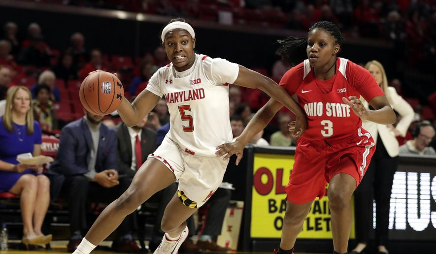 In this Monday, Jan. 6, 2020, file photo, Maryland guard Kaila Charles (5) drives against Ohio State guard Janai Crooms (3) during the second half of an NCAA college basketball game in College Park, Md.  (AP Photo/Julio Cortez, File)  **FILE**