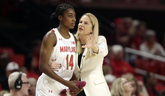 In this Monday, Jan. 6, 2020, file photo, Maryland head coach Brenda Frese, right, talks with guard Diamond Miller during the second half of an NCAA college basketball game against Ohio State in College Park, Md. Riding a five-game winning streak and closing in on its customary perch atop the Big Ten standings, the 17th-ranked Maryland women's basketball team turned around its season with a minimum of assistance from fiery coach Brenda Frese. (AP Photo/Julio Cortez, File)  **FILE**