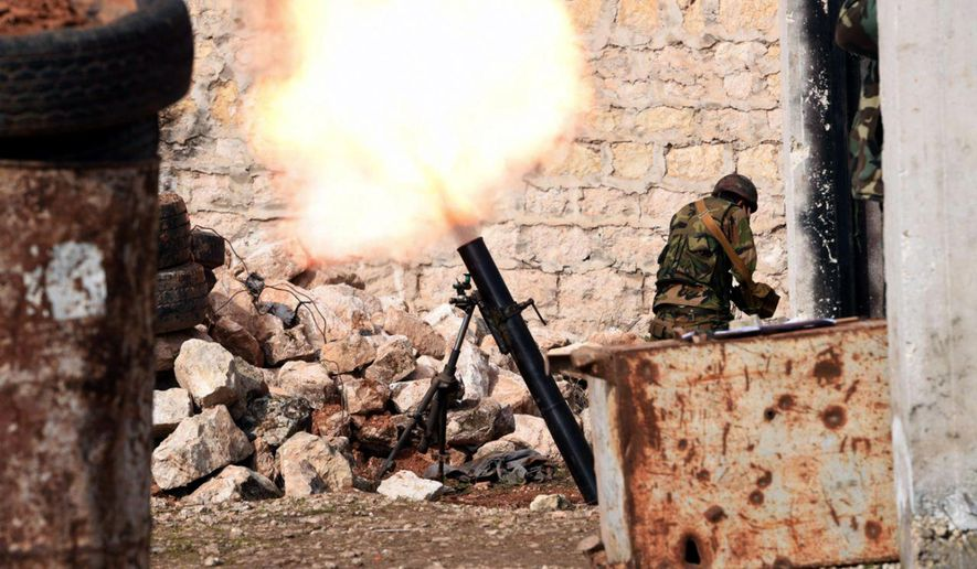 This Monday, Jan. 27, 2020, photo, released by the Syrian official news agency SANA, a Syrian army soldier launches a mortar round toward insurgents on the western rural Aleppo, Syria. Syrian government forces pressed in their offensive Tuesday, Jan. 28, 2020, closing in on a major rebel stronghold in the northwestern province of Idlib and marching against insurgents west of Aleppo, Syria's largest city, state media and opposition activists said Tuesday. (SANA via AP)