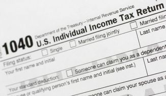 This July 24, 2018, file photo shows a portion of the 1040 U.S. Individual Income Tax Return form. The IRS began accepting and processing tax returns for individuals on Monday, Jan. 27, 2020. (AP Photo/Mark Lennihan, File)
