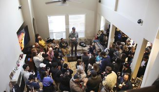 In this January 11, 2020 photo former congressman, US Senate and Presidential candidate Beto O'Rourke speaks before a crowd of campaign volunteers for Eliz Markowitz in Katy, Texas. Markowitz is an educator running for district 148 of the Texas state house. O'Rourke and other national Democrats have endorsed Markowitz, her race is being viewed as a bellwether for national politics in 2020. (AP Photo/ John L. Mone)