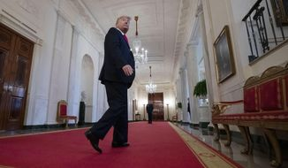 President Donald Trump departs after an event with Israeli Prime Minister Benjamin Netanyahu in the East Room of the White House in Washington, Tuesday, Jan. 28, 2020, to announce the Trump administration's much-anticipated plan to resolve the Israeli-Palestinian conflict. (AP Photo/Alex Brandon)