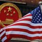 The arrests and indictments are the latest in a series of Justice Department actions against Chinese high-tech spying and technology theft. (Associated Press)