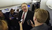 U.S. Secretary of State Mike Pompeo speaks to reporters aboard his plane en route to London, Wednesday Jan. 29, 2020.  Pompeo, is due to arrive in London Wednesday to meet British Prime Minister Boris Johnson and other officials.(Kevin Lamarque/Pool via AP)