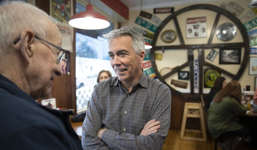 Republican presidential candidate former Rep. Joe Walsh, R-Ill., center, speaks with Ernie Rairdin, left, during a campaign event at Riley's Cafe, Wednesday, Jan. 29, 2020, in Cedar Rapids, Iowa. (AP Photo/Matt Rourke) ** FILE **