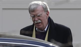 Former National security adviser John Bolton leaves his home in Bethesda, Md. Wednesday, Jan. 29, 2020. (AP Photo/Luis M. Alvarez)