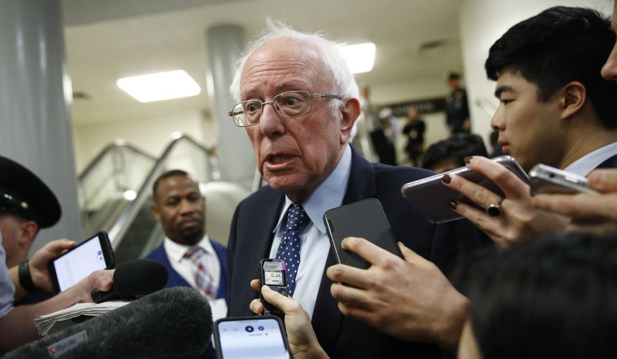 Sen. Bernie Sanders, I-Vt., speaks with reporters during the impeachment trial of President Donald Trump on charges of abuse of power and obstruction of Congress on Capitol Hill in Washington, Wednesday, Jan. 29, 2020. (AP Photo/Patrick Semansky)