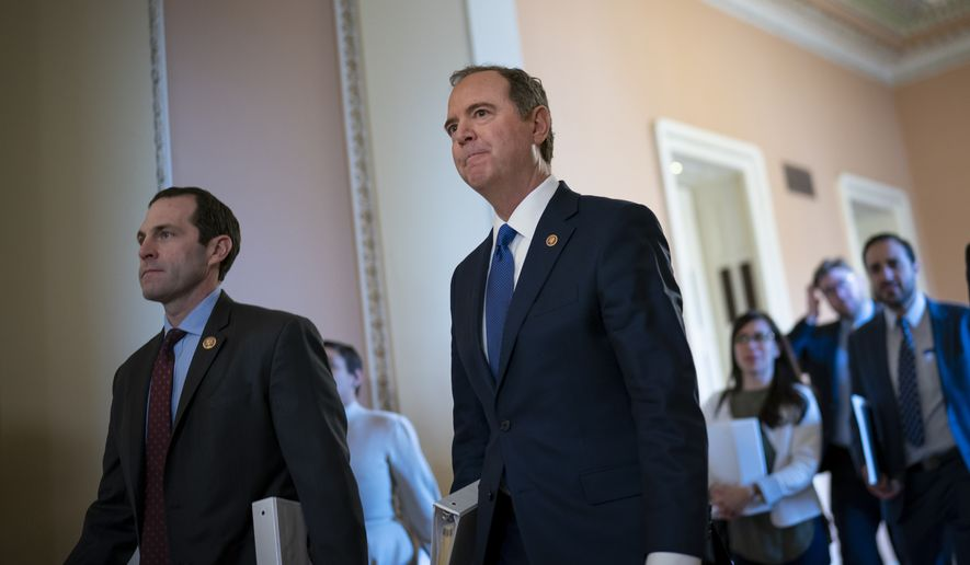 Democratic impeachment managers, House Intelligence Committee Chairman Adam Schiff, D-Calif., and Rep. Jason Crow, D-Colo., left, arrive as President Donald Trump's impeachment trial shifts to questions from senators, a pivotal juncture as Republicans lack the votes to block witnesses and face a potential setback in their hope of ending the trial with a quick acquittal, at the Capitol in Washington, Wednesday, Jan. 29, 2020. (AP Photo/J. Scott Applewhite)
