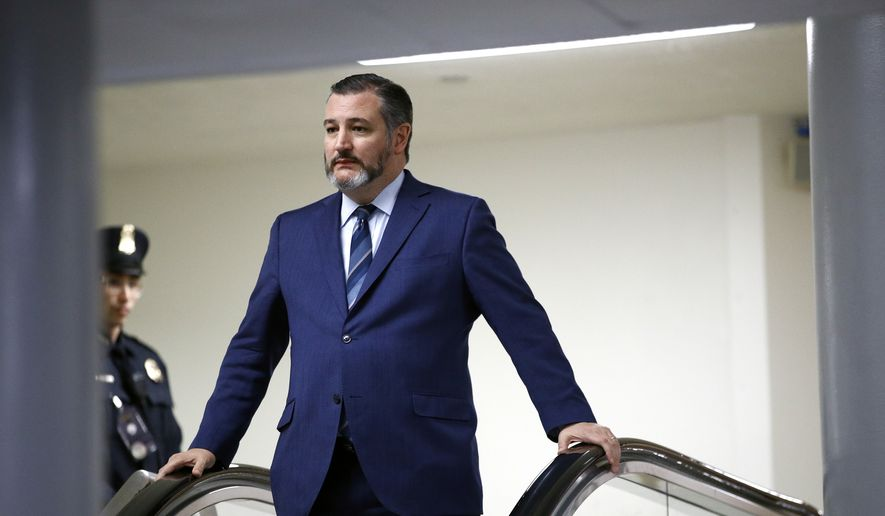 Sen. Ted Cruz, R-Texas, rides an escalator before speaking with reporters during the impeachment trial of President Donald Trump on charges of abuse of power and obstruction of Congress on Capitol Hill in Washington, Wednesday, Jan. 29, 2020. (AP Photo/Patrick Semansky)