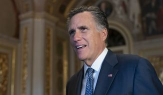 Sen. Mitt Romney, R-Utah, talks to a reporter outside the Senate chamber during a break in President Donald Trump's impeachment trial, at the Capitol in Washington, Wednesday, Jan. 29, 2020.  (AP Photo/J. Scott Applewhite)