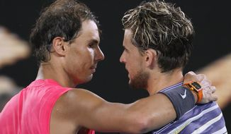 Austria's Dominic Thiem, right, is congratulated by Spain's Rafael Nadal after winning their quarterfinal match at the Australian Open tennis championship in Melbourne, Australia, Wednesday, Jan. 29, 2020. (AP Photo/Andy Wong)